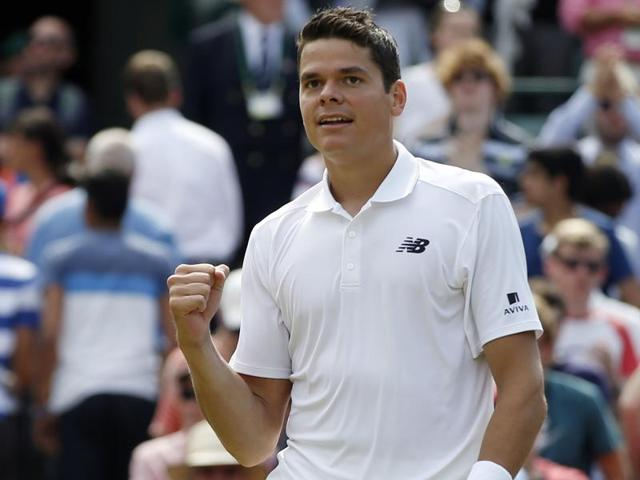 Milos Raonic shakes hands with Sam Querrey at the net after the match.