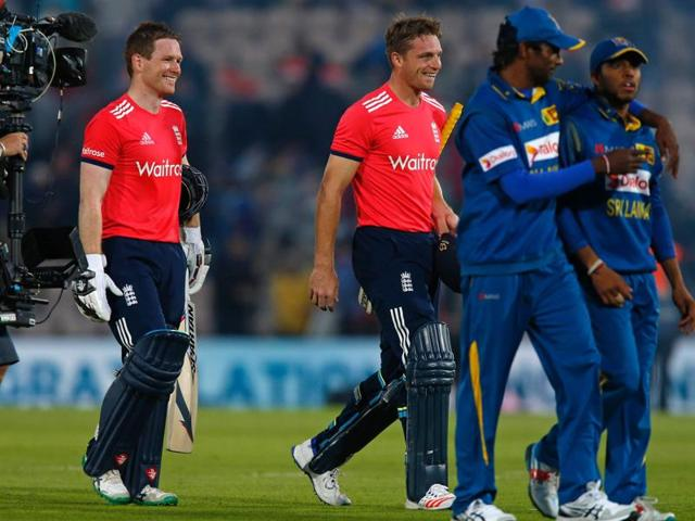 England's Captain Eoin Morgan (left) and Jos Buttler leave the field after England win the game by 8 wickets in the T20 international cricket match between England and Sri Lanka at The Ageas Bowl in Southampton, on the south coast of England.
