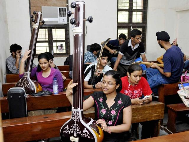 Students practise before an extra curricular activity trial in a Delhi University college.