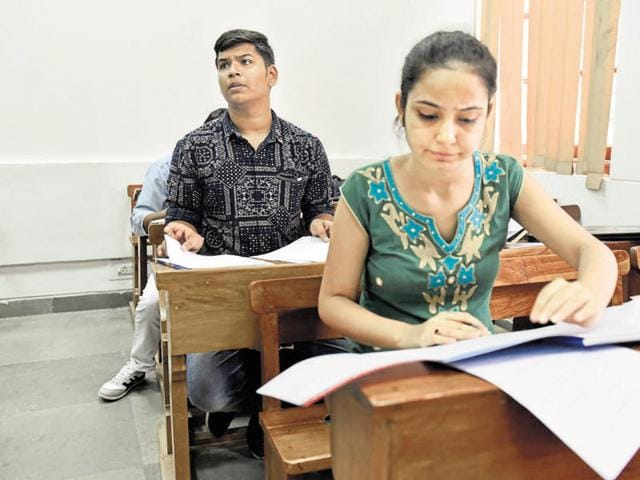 Students fill admission forms at SRCC in New Delhi on Tuesday.