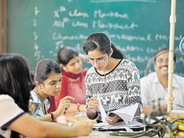 Students fill admission forms at Daulat Ram College on Tuesday.