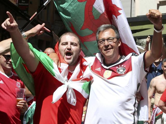 Wales and Germany fans gather ahead of the Wales v Portugal semi-final match in Lyon.