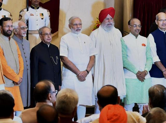 President Pranab Mukherjee with newly inducted ministers at a swearing-in-ceremony at the Rashtrapati Bhavan in New Delhi.