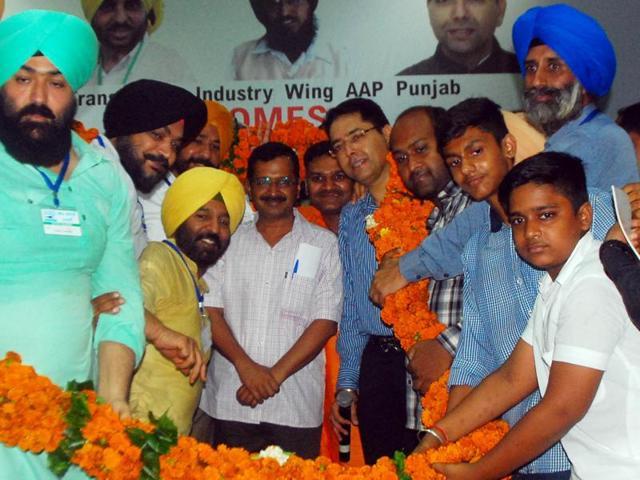 Delhi CM Arvind Kejriwal with AAP workers at Guru Nanak Bhawan in Ludhiana on Tuesday.