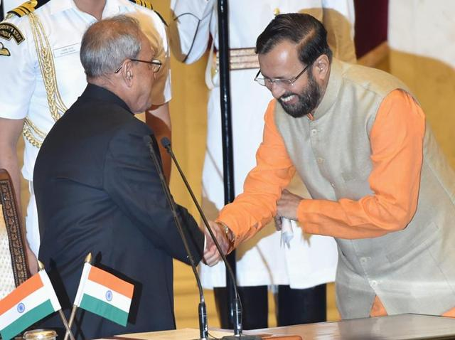 President Pranab Mukherjee greets Prakash Javadekar after administering the oath of office to him as a cabinet minister during a swearing-in ceremony at Rashtrapati Bhavan in New Delhi on Tuesday.