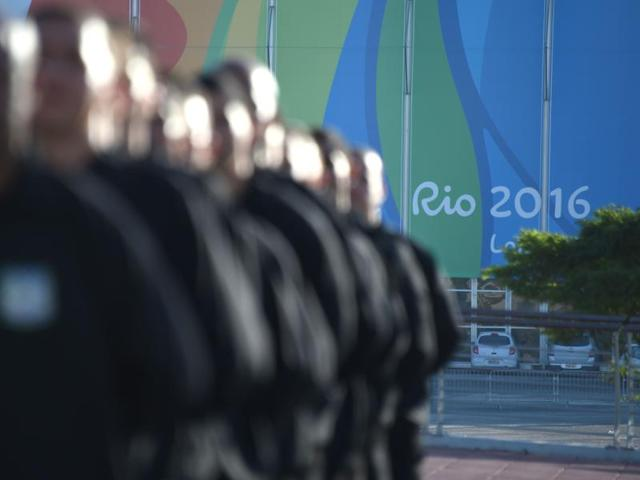 Rio puts on an optimistic face with a month to go for Olympics
