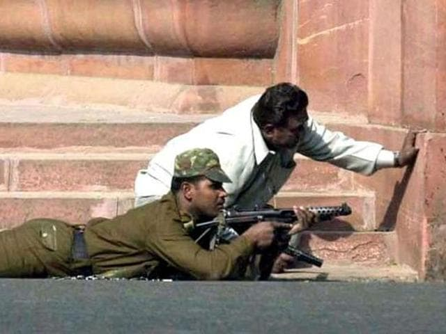 File photo of a commando taking position beside a plainclothes policeman near the Parliament in New Delhi after it was attacked by terrorists on December 13, 2001.