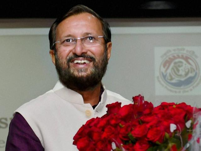 New HRD Minister Prakash Javadekar is greeted by an official after he handed over the charge of Environment Ministry to Anil Madhav Dave at Paryavaran Bhawan in New Delhi.