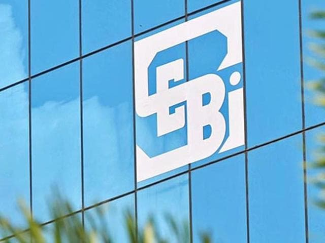 The logo of the Securities and Exchange Board of India (Sebi), country's market regulator, is seen on the facade of its head office building in Mumbai. (Reuters)