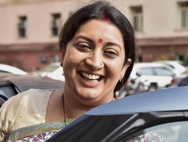 Bharatiya Janata Party legislator Smriti Irani leaves her office after taking charge of the textiles ministry in New Delhi on Wednesday.(PTI)