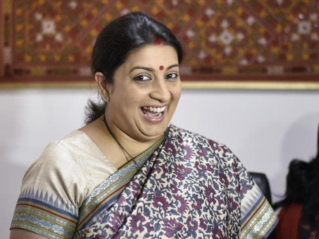 Smriti Irani takes charge as textile minister at Udyog Bhawan in New Delhi on Wednesday.