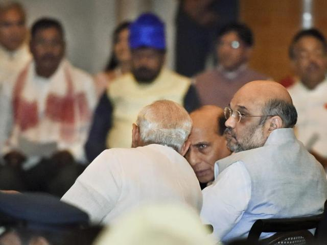 Prime Minister Narendra Modi with BJP president Amit Shah and home minister Rajnath Singh at the swearing-in ceremony of new ministers at the Rashtrpati Bhawan.