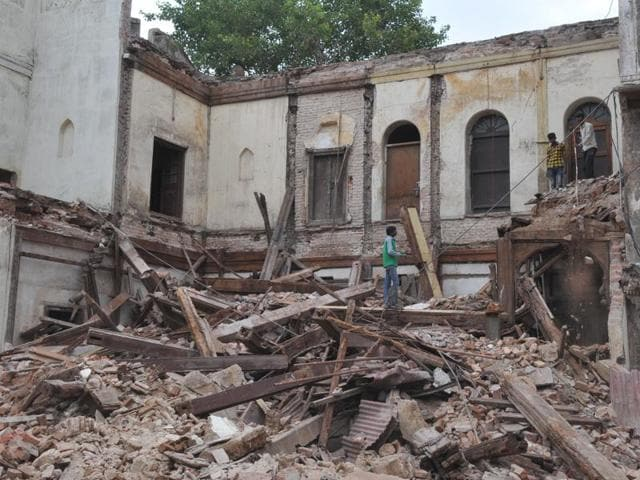 Workers remove debris from Rajwada Palace in Indore on Tuesday.