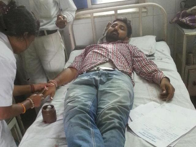 Injured journalist Krishna Kumar Tiwari being treated at JP Hospital in Bhopal.