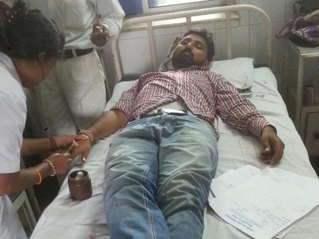 Injured journalist Krishna Kumar Tiwari being treated at JP Hospital in Bhopal.
