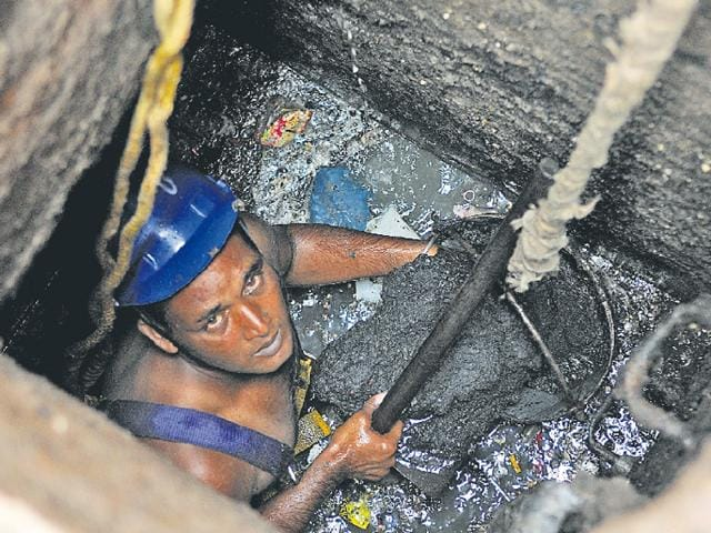 A sewer man on the job with partial safety gear in Jalandhar.