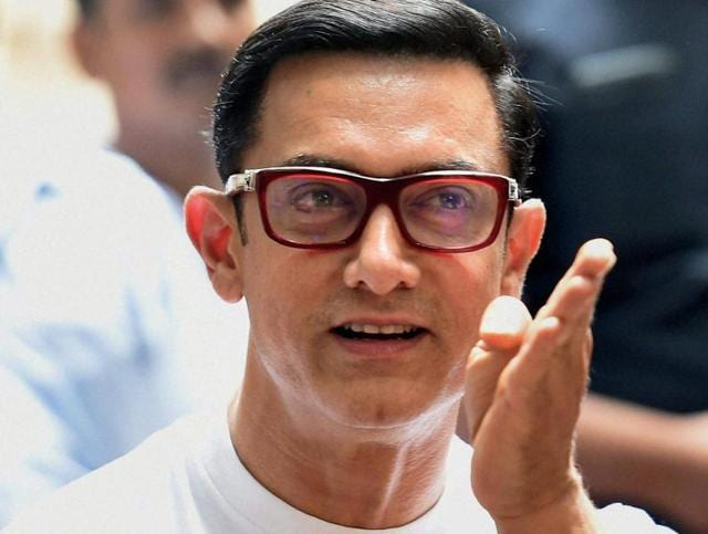Bollywood actor Aamir Khan interacts with journalists on the occasion of Eid-ul-Fitr at his residence in Mumbai.