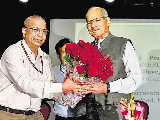 Newly-appointed environment minister Anil Madhav Dave takes charge at Paryavaran Bhawan in New Delhi on Wednesday.