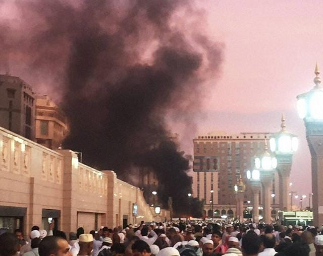Muslim worshippers gather after a suicide bomber detonated a device near the security headquarters of the Prophet's Mosque in Medina.