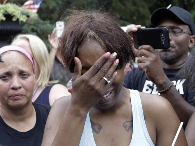 Diamond Reynolds, the girlfriend of Philando Castile of St. Paul, cries outside the governor's residence in St. Paul, Minnesota.