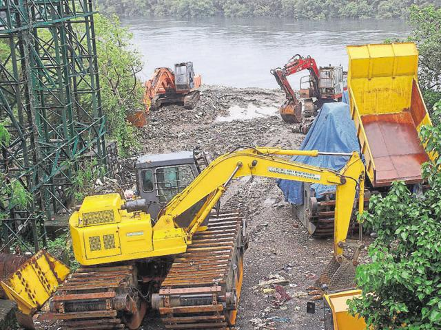 Less then a kilometer away from the state mangrove cell, HTspotted construction machiney and debris dumped along the Mahim -Bandra creek  on Monday.