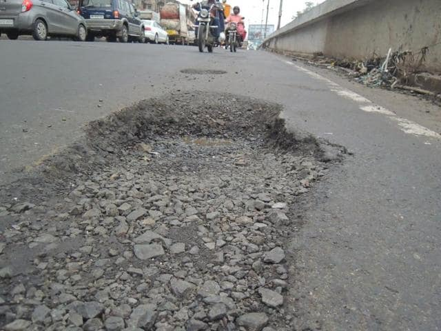 Potholes have surfaced on a flyover at Dadar.