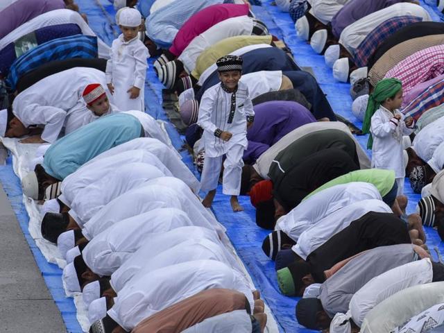 Muslims offer Eid al-Fitr prayers outside Bandra Station in Mumbai.