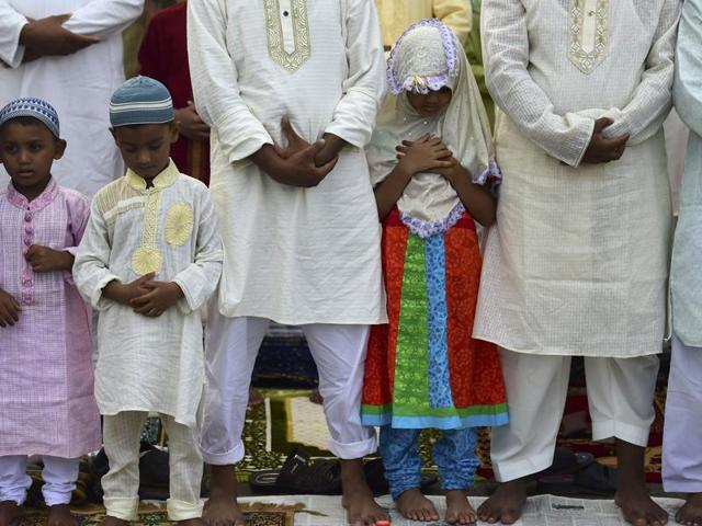 Bangladeshi Muslims offer Eid al-Fitr prayers in Dhaka on July 7, 2016. Suspected Islamists carried out a new deadly attack at a huge prayer gathering in Kishoregunj town to celebrate the end of Ramadan, only days after the mass murder of hostages in the capital Dhaka. /