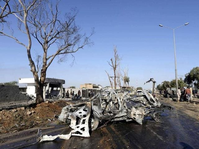 A damaged army vehicle is seen after a suicide bombing at an army camp in Benghazi.