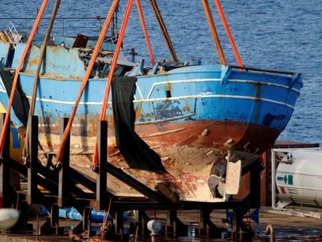 The wreck of a fishing boat that sank in April 2015, drowning hundreds of migrants packed on board, is seen after being raised in the Sicilian harbour of Augusta, Italy.