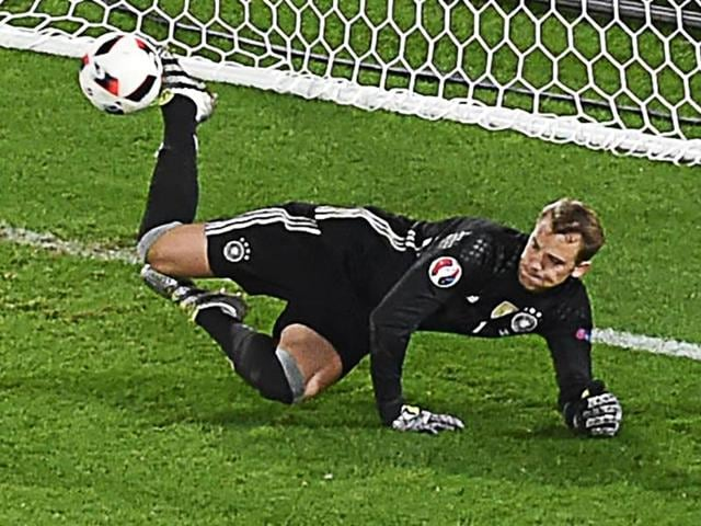 Germany's goalkeeper Manuel Neuer stops the ball during a penalty shootout of the Euro 2016 quarterfinal football match between Germany and Italy at the Matmut Atlantique stadium in Bordeaux.