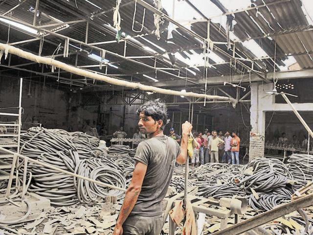 The shattered roof of a rubber factory after the blast in Jalandhar on Wednesday.
