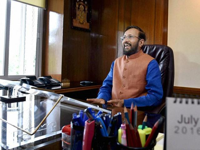 New HRD minister Prakash Javadekar takes charge of his office in New Delhi on Thursday.