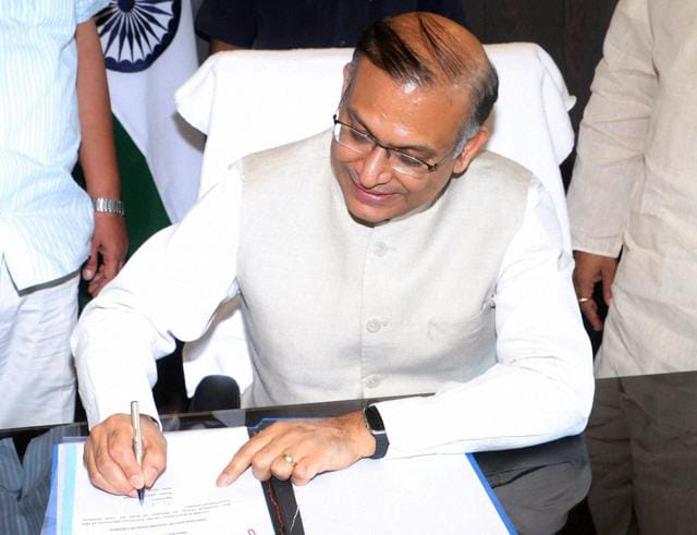 Jayant Sinha takes charge as minister of state for civil aviation in New Delhi on Wednesday.