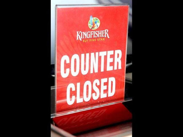 A sign at the closed Kingfisher Airlines booking counter at the city airport in Mumbai.