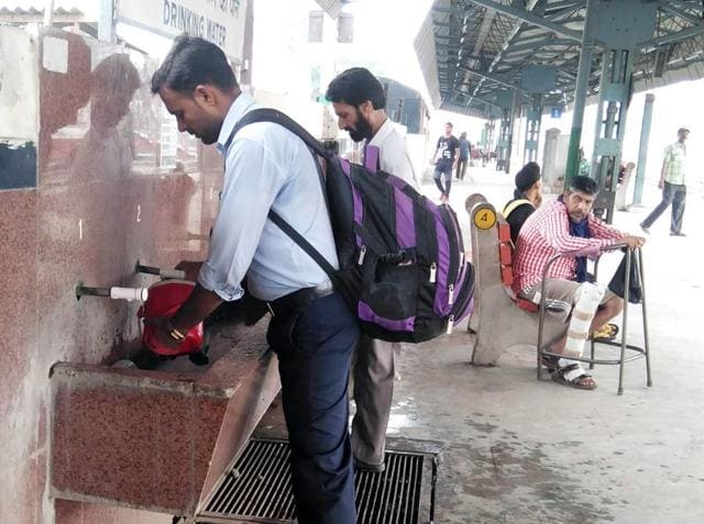 Passengers drinking water at the railway station in Ludhiana on Wednesday.