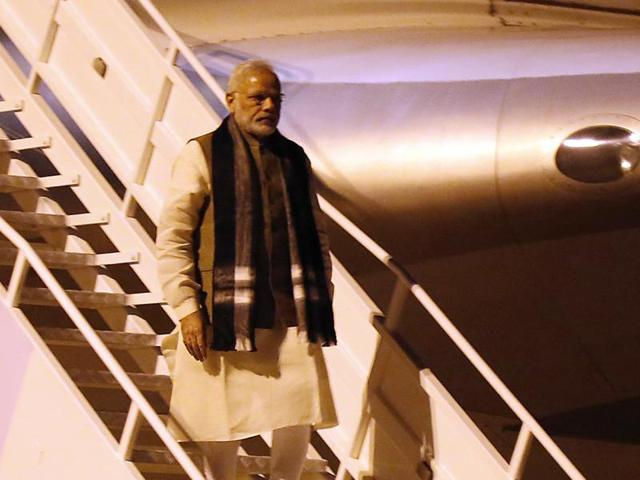 Indian Prime Minister Narendra Modi, left, greets officials as he arrives at the airport in Mozambique, on Thursday. India will enter into a government-to-government pact with Mozambique to import pulses there.