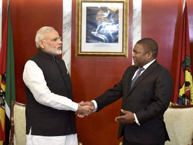 Prime Minister Narendra Modi shakes hands with  Mozambique President Filipe Jacinto Nyusi during a restricted meeting at Presidential Office in Maputo.