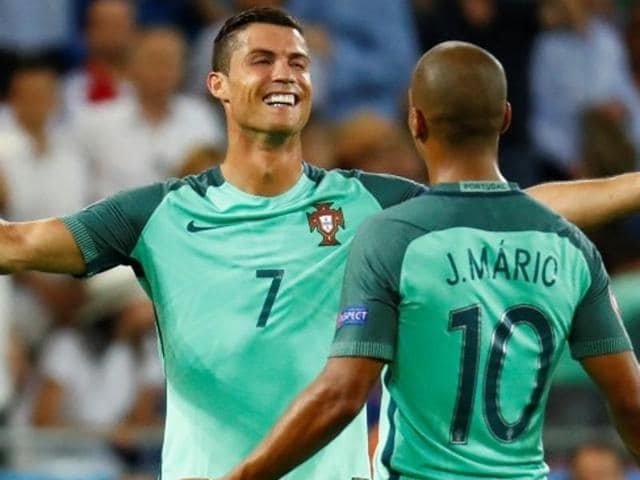 Portugal's forward Cristiano Ronaldo (C) and Portugal's defender Fonte celebrate after Portugal beat Wales.