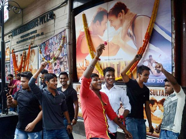 Fans of Salman Khan dance at a theatre in Kolkata on Wednesday after the actor's new movie Sultan was released.