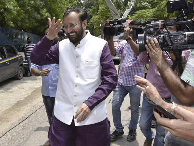 Newly-appointed HRD minister Prakash Javadekar after meeting predecessor Smriti Irani on Wednesday.