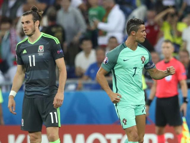 Portugal's Cristiano Ronaldo  right) celebrates scoring the opening goal next to Wales' Gareth Bale during the Euro 2016 semifinal match at the Grand Stade in Lyon, France.