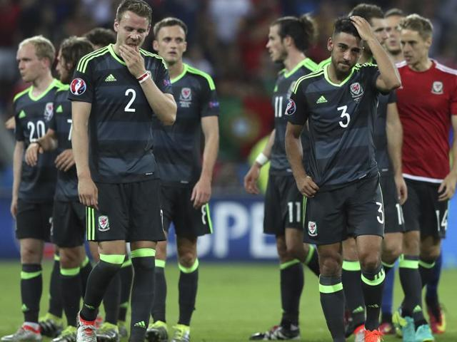 Wales's team react at the end of the Euro 2016 semifinal football match between Portugal and Wales, at the Grand Stade in Decines-­Charpieu, near Lyon.