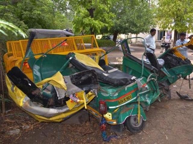 The wreckage of the autorickshaw and the BMW sedan after the accident in Jaipur. (HTPhoto)