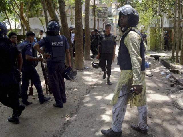 Bangladeshi policemen arrive near the scene of a blast in Kishoreganj, about 90 kilometers (60 miles) north of the capital of Dhaka.