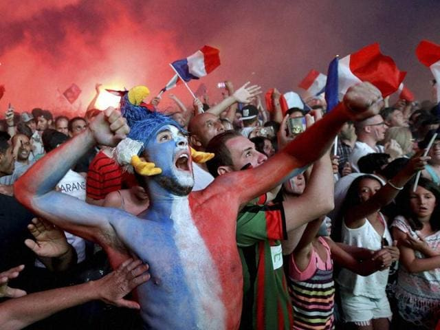 Supporters celebrate their team's first goal in the Marseille fan zone during the Euro 2016 semifinal football match between Germany and France.