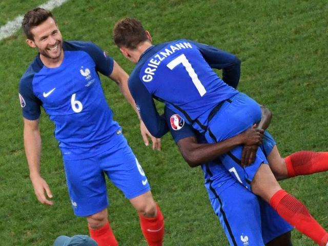 (Left to right) France's Yohan Cabaye, Antoine Griezmann and team mates celebrate after the Euro 2016 semifinal football match between Germany and France at the Stade Velodrome in Marseille.