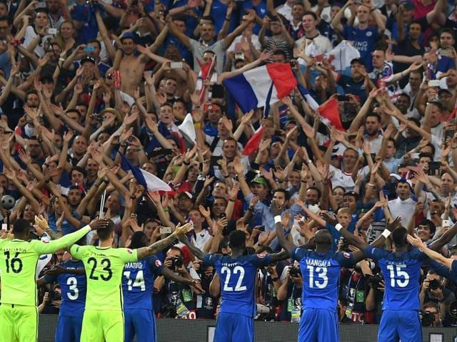 France players acknowledge the fans after beating Germany 2-0 in the Euro 2016 semifinal football match between Germany and France at the Stade Velodrome in Marseille.