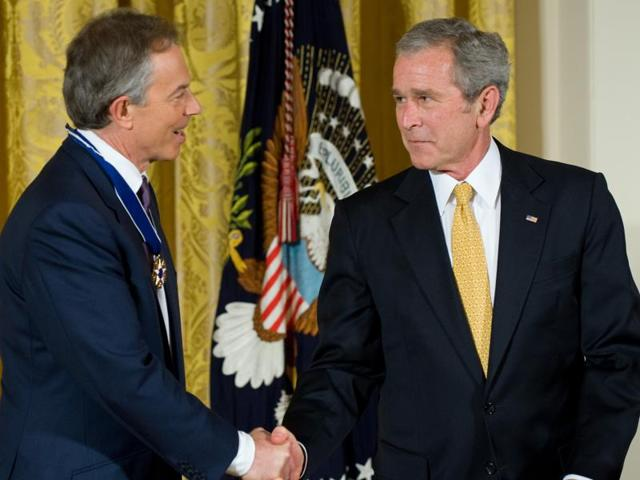 This January 12, 2009 file photo shows US President George W Bush presenting the Presidential Medal of Freedom to former British Prime Minister Tony Blair at the White House in Washington, DC. Bush reiterated his belief on Wednesday that the world is