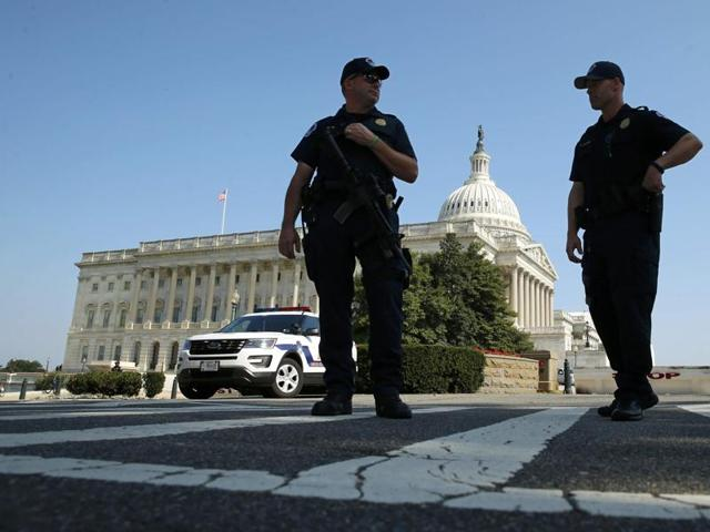 US Capitol Police officers stand outside the US Capitol after police ordered a lockdown of in Washington, US, July 8, 2016.
